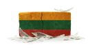 Brick with broken glass, violence concept, flag of Lithuania