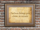 Old wooden frame with written text on an old wall - Failure brings you closer to success