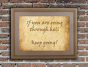 Old wooden frame with written text on an old wall - Keep going
