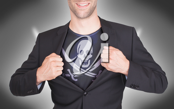 Businessman opening suit to reveal shirt with pirate flag