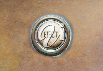 Grunge image of an old button - eject