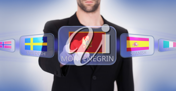 Hand pushing on a touch screen interface, choosing language or country, Montenegro