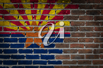 Very old dark red brick wall texture with flag - Arizona
