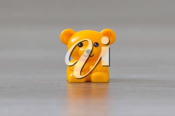 Small yellow bear on a wooden floor