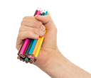 Used pencils in hand isolated on white background