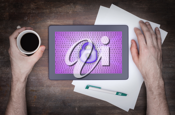 Tablet on a desk, concept of data protection, purple