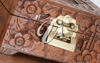 Very old wooden chest with simple lock, selective focus