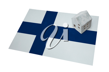 Small house on a flag - Living or migrating to Finland