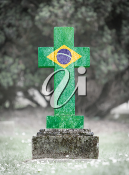 Old weathered gravestone in the cemetery - Brazil
