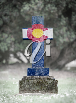 Old weathered gravestone in the cemetery - Colorado