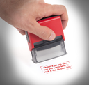 Plastic stamp in hand, isolated on white - Choose a job you love and you never have to work a day in your life