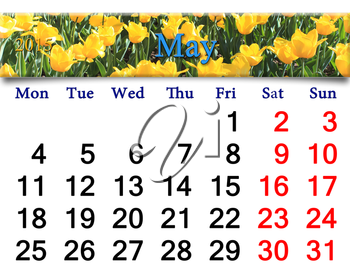 calendar for May of 2015 with flower bed of yellow tulips