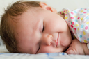 Image of beautiful cute sleeping newborn girl