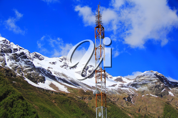 Photo of electricity tower in Caucasus mountains
