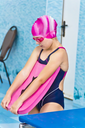Photo of jumping girl in swimming pool