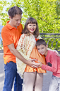 Happy family son listens to pregnant belly of his mother