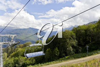 Pictureque landscape with empty funicular in green Caucasus mountains