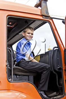 Cute smiling boy are sitting in fire engine