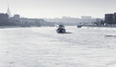 iceboat on frozen Moscow river in sunny winter day