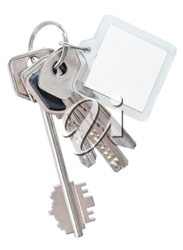 several keys on steel ring and keychain isolated on white background