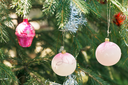 pink balls and house christmas tree vintage decoration close up