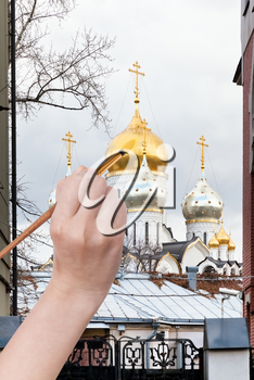 travel concept - hand paints by painbrush golden dome of russian church in autumn