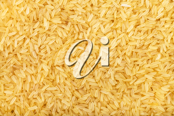 food background - yellow parboiled long-grain Indica rice