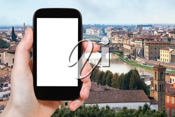 travel concept - tourist photographs Florence city with arno river on smartphone with cut out screen with blank place for advertising in Italy
