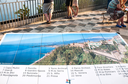 TAORMINA, ITALY - JULY 2, 2011: city map on viewpoint in Piazza IX Aprile in Taormina city in Sicily. Piazza IX Aprile is central square of Taormina town.