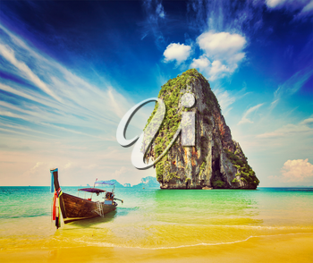 Retro vintage hipster style image of tropical vacation holiday beach concept - Long tail boat on tropical beach, Krabi, Thailand