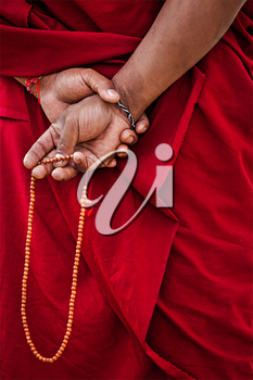 Tibetan Buddhism - prayer beads in Buddhist monk hands. Ladakh, India