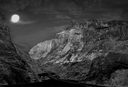 Night mountains landscape with fool moon.Monochrome toned image.