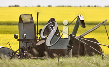 Vintage Farm Equipment against Canalo Background Canada