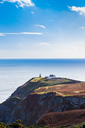 View of the trails on Howth Cliffs and Howth Head with the lighthouse in Ireland