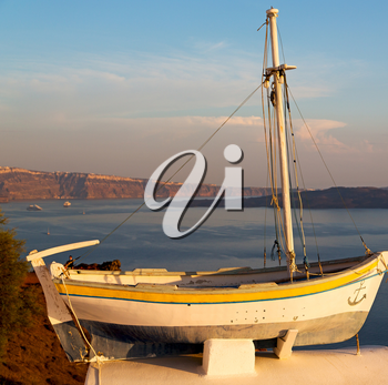 sailing in europe greece santorini island hill  and rocks on the summertime beach sunset boat