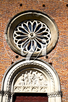 italy  lombardy     in  the castellanza   old   church   closed brick tower   wall rose   window tile