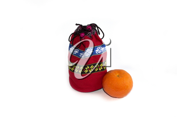 bag with gifts and tangerine