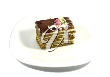 brown cake on a white plate, on a white background