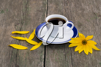 coffee, bright yellow flower and yellow petals, still life subject flowers and drinks, spring, summer