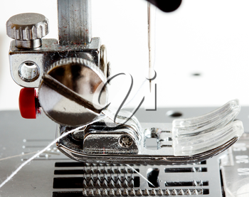 Close-up of modern sewing machine foot