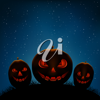 Halloween Holiday pumpkins on dark night background. Scary smiling pumpkin faces in darkness and starlight backdrop