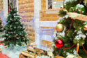 Background on the topic of Christmas and New Year. House of Santa Claus, Christmas trees and reindeer of Christmas lights.