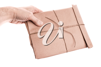 Man's hand holds envelope tied with a rope isolated on white background