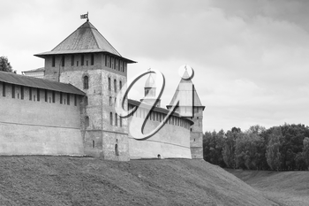 Novgorod Kremlin or Detinets. Bank of the Volkhov River in old russian town Veliky Novgorod. Black and white photo
