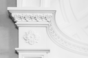 Column with stucco relief molding, abstract white interior in classical style