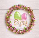 Easter Festive Twigs Wreath with Flowers on Light Wooden Background