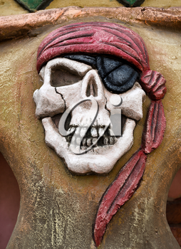 Pirate symbol - skull with eye patch and red bandana
