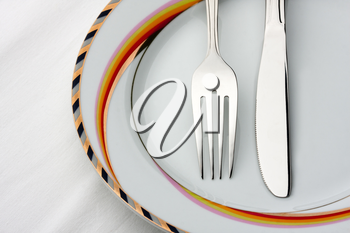 Fork and knife on the plate