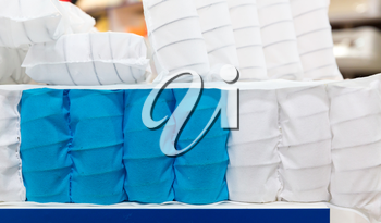 Mattress spring seal with white and blue fabric, background