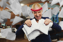 Angry businesswoman tearing papers in pieces in the office